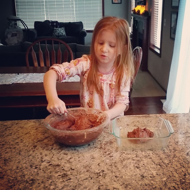 Daphne baking her brother's birthday cake.
