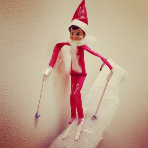 Skiing down the banister.  Fake snow, popscicle stick skis, surprisingly easy.  Put a little baking soda on his knees and hat.