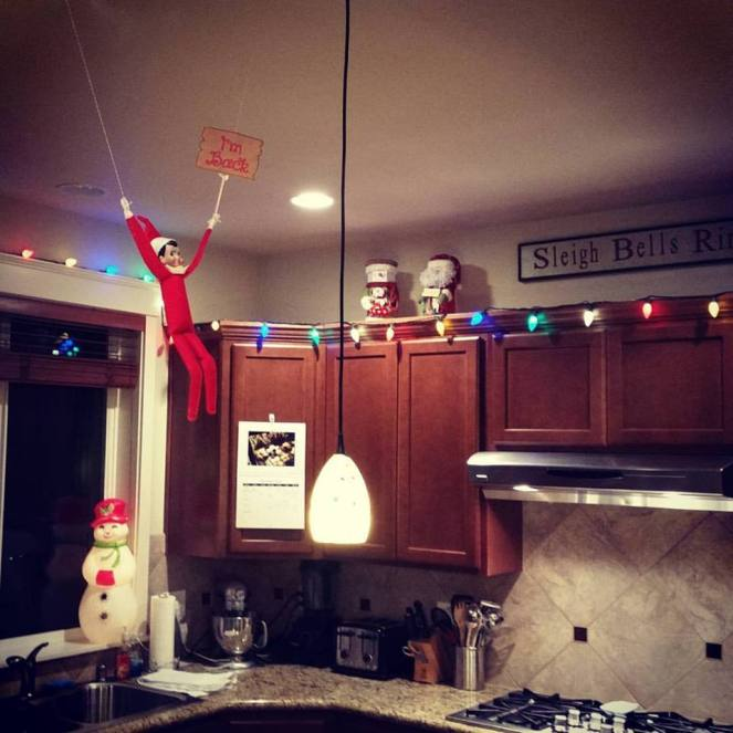 Elf Arrival - hung from the ceiling with push pins and twine, and a sign I got on Etsy for $2.00