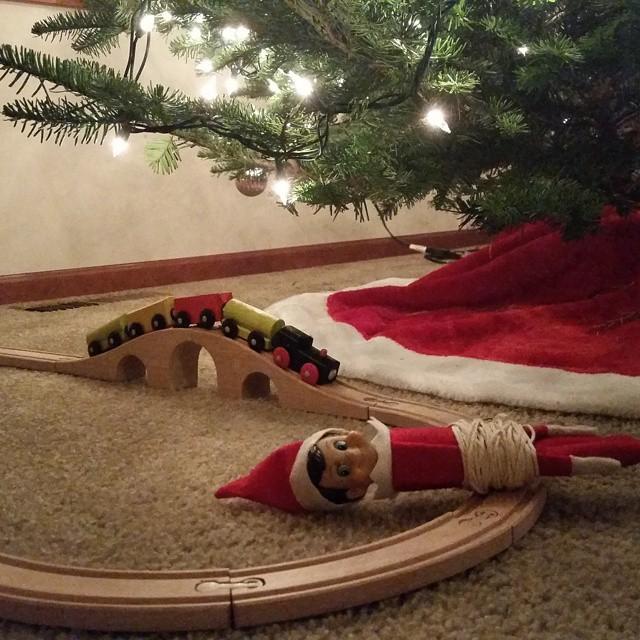 Elf on the train tracks